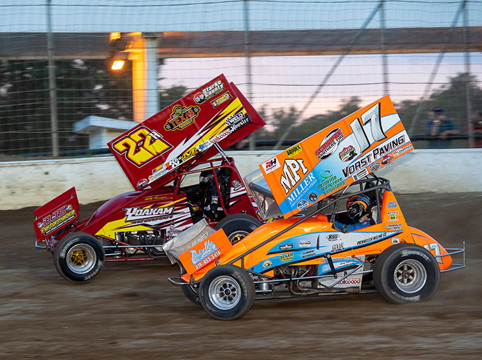 Jared Horstman (17) passes leader Randy Hannagan en route to victory in Friday's K&L Ready Mix NRA Sprint Invaders feature at Limaland Motorsports Park. (Mike Campbell Photo)