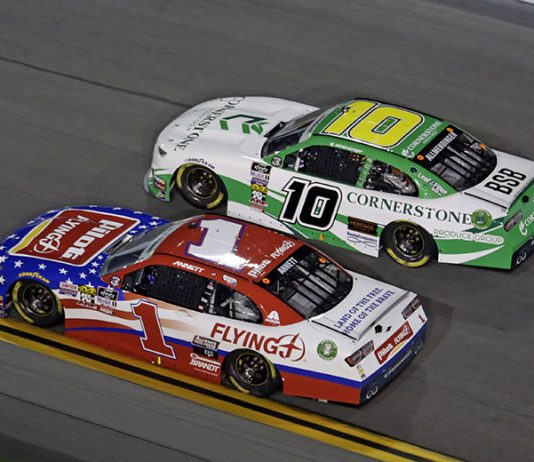 A.J. Allmendinger (10) battles Michael Annett Friday at Daytona Int'l Speedway. (HHP/Alan Marler Photo)