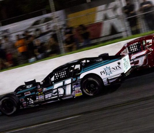 Justin Bonsignore (51) races to the inside of John Beatty Jr. Saturday night at Riverhead Raceway. (NASCAR Photo)