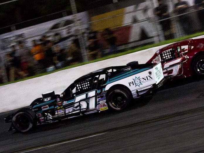 Justin Bonsignore (51) races to the inside of John Beatty Jr. Saturday night at Riverhead Raceway. (NASCAR Photo)