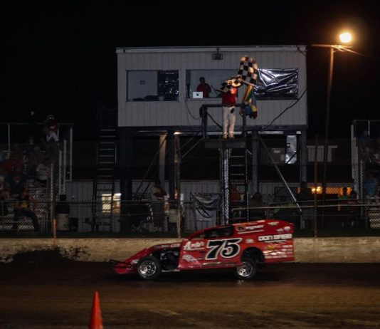 Terry Phillips takes the checkered flag at Central Missouri Speedway.