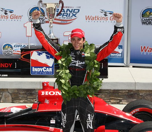 Justin Wilson celebrates an Indy car victory at Watkins Glen Int'l in 2009. (IndyCar Photo)