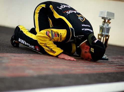 Paul Menard kisses the bricks at Indianapolis Motor Speedway after winning the 2011 Brickyard 400. (NASCAR Photo)