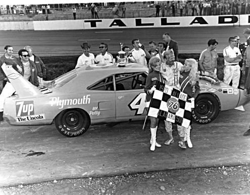 Pete Hamilton poses with the checkered flag after winning at Talladega Superspeedway in 1970. His victory in the Daytona 500 that same season was one of NASCAR's biggest upsets. (NASCAR Photo)