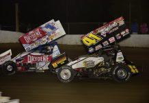 David Gravel (41) races under Logan Schuchart at Hartford (Mich.) Speedway. (Mark Funderburk photo)