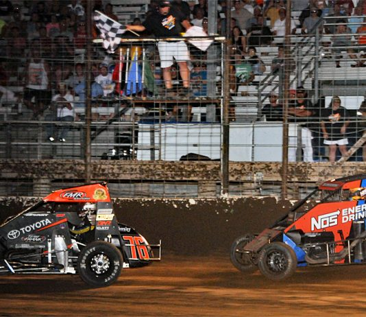 Jason McDougal (76) leads Tyler Courtney under the checkered flag at Jefferson County Speedway. (TWC photo)