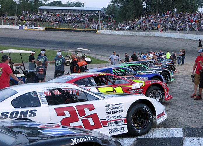 The field for Tuesday's SUPERSEAL Slinger Nationals waits for the command at Slinger Super Speedway. (Nick Dettmann Photo)