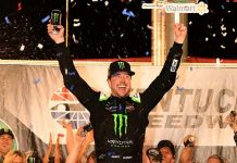 Kurt Busch celebrates after winning Saturday's Quaker State 400 at Kentucky Speedway. (Kent Steele Photo)