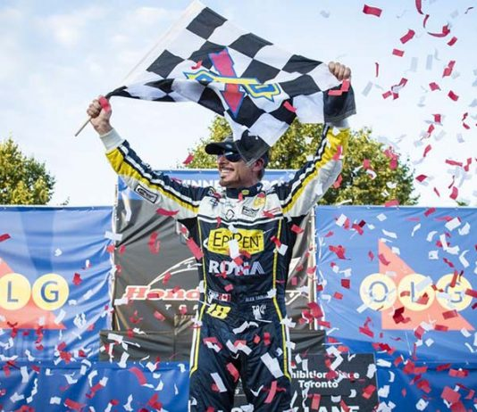 Alex Tagliani celebrates after his victory on the streets of Toronto Saturday afternoon. (NASCAR Photo)
