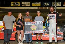 Kip Hughes in victory lane Saturday at Dodge City Raceway Park.