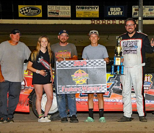 Kip Hughes in victory lane Saturday at Dodge City Raceway Park.