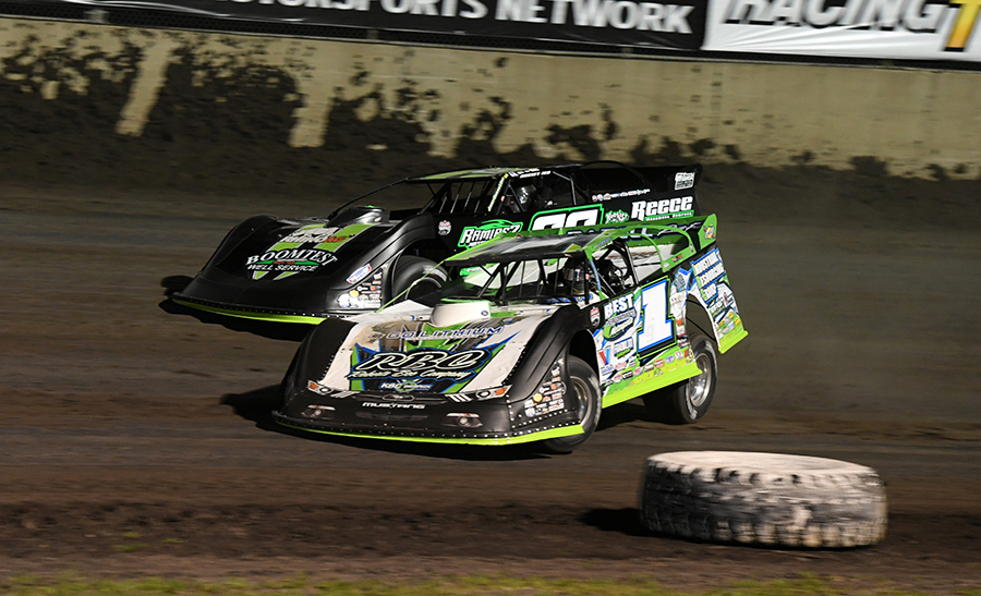 Tyler Erb (1) battles Jimmy Owens during Thursday's Lucas Oil Late Model Dirt Series feature at Tri-City Speedway. (Don Figler Photo)