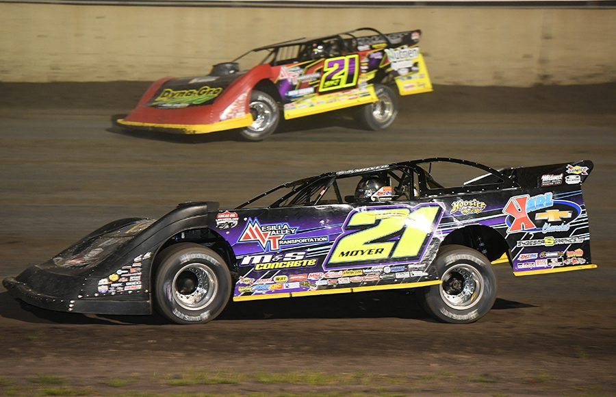 Billy Moyer (21) battles to the inside of his son, Billy Moyer Jr., during Thursday's Lucas Oil Late Model Dirt Series feature at Tri-City Speedway. (Don Figler Photo)