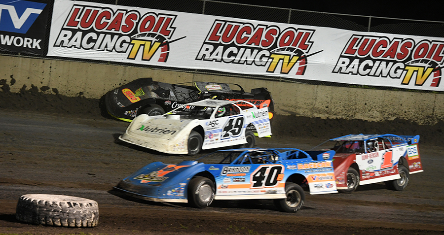 Jonathan Davenport (49) makes contact with Michael Norris (5) as Kyle Bronson drives by on the inside during Thursday's Lucas Oil Late Model Dirt Series feature at Tri-City Speedway. (Don Figler Photo)