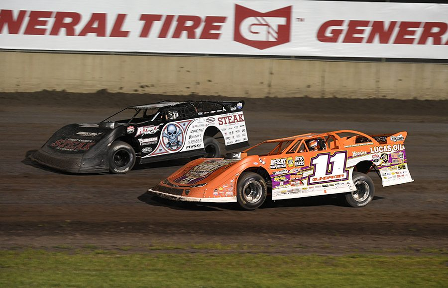 Gordy Gundaker (11) works under Scott Bloomquist Jonathan Davenport (49) makes contact with Michael Norris (5) as Kyle Bronson drives by on the inside during Thursday's Lucas Oil Late Model Dirt Series feature at Tri-City Speedway. (Don Figler Photo)
