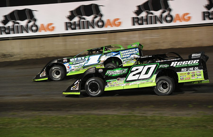 Tyler Erb (1) battles by Jimmy Owens Gordy Gundaker (11) works under Scott Bloomquist Jonathan Davenport (49) makes contact with Michael Norris (5) as Kyle Bronson drives by on the inside during Thursday's Lucas Oil Late Model Dirt Series feature at Tri-City Speedway. (Don Figler Photo)