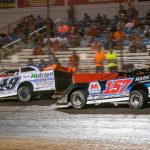 Jonathan Davenport and Mike Marlar battle in the closing laps Sunday night at Lucas Oil Speedway. (Kenny Shaw photo)