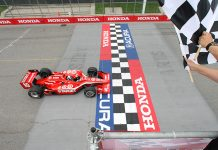 Dario Franchitti takes the checkered flag to win the 2009 Honda Indy Toronto. (IndyCar Photo)