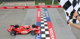 Dario Franchitti takes the checkered flag to win the 2009 Honda Indy Toronto. (IndyCar Photo)