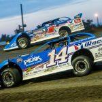 Josh Richards (14) races under Brandon Sheppard at Brown County Speedway. (Heath Lawson photo)
