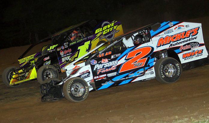 Ronnie Johnson (2) battles Rocky Warner on Friday night at Albany-Saratoga Speedway. (Dave Dalesandro Photo)