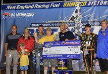 Matt Goslant, New Hampshire Motor Speedway's vice president of operations and development (far left) and David McGrath, New Hampshire Motor Speedway's executive vice president and general manager (third from left) with Chris Transeau, winner of the U.S. Legend Cars International feature (holding check) and Monster Energy NASCAR Cup Series driver Daniel Hemric (second from right), who finished second during the Friday Night Dirt Duels presented by New England Racing Fuel at New Hampshire Motor Speedway's newest racing surface, The Flat Track, on Friday. (NHMS/Alan MacRae Photo)