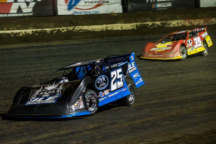 Mason Zeigler (25z) races ahead of Tim McCreadie Friday night at I-80 Speedway. (Heath Lawson Photo)