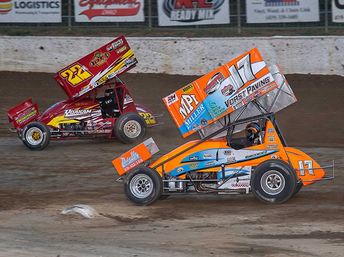 Jared Horstman (17) slides under Randy Hannagan during the K&L Ready Mix NRA Sprint Invader feature Friday at Limaland Motorsports Park. (Mike Campbell Photo)