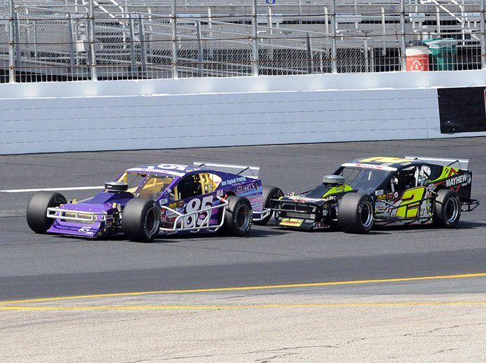 Ron Silk (85) races ahead of Doug Coby on Saturday at New Hampshire Motor Speedway. (Dave Moulthrop Photo)