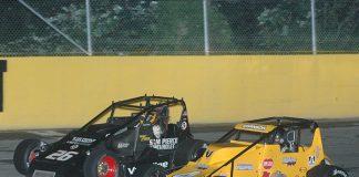 Kody Swanson (4) battles alongside Aaron Pierce on Saturday night at Berlin Raceway. (David Sink Photo)