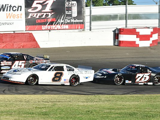 Jason Romero (8) and Jeremy Doss (75) split a pair of twin late model races on Saturday night at All American Speedway. (Don Thompson Photo)