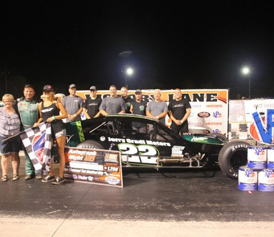 Chuck Hossfeld and his crew pose in victory lane Saturday night Lancaster Speedway @ New York Int'l Raceway Park. (Paula Thompson Photo)
