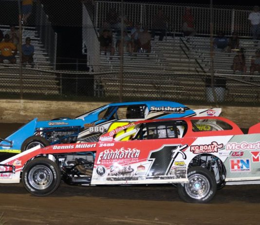 Tim Karrick (1k) battles Dean Wille Saturday night at Central Missouri Speedway. (Joshua Allee Photo)