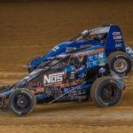 Justin Grant (4) races under Kyle Cummins at Lawrenceburg Speedway. (Dallas Breeze photo)