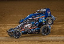 Justin Grant (4) races under Kyle Cummins at Lawrenceburg Speedway. (Dallas Breeze photo)
