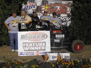 Kevin Olson is joined by car owner Don Kleven and crew after winning the Badger Midget Series Sunday at Angell Park Speedway. (Bob Cruse Photo)