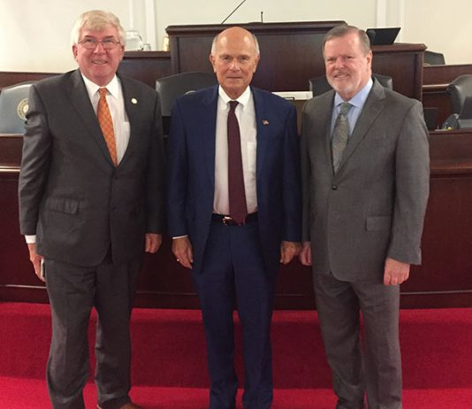 From left, North Carolina State Senator Tom McInnis, Rockingham Dragway's Steve Earwood and North Carolina Senate President Pro-Tem Phil Berger on Tuesday on the floor of the North Carolina General Assembly.