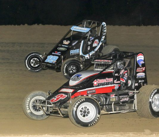 Kyle Cummins (3c) races under C.J. Leary at Lincoln Park Speedway. (Dick Ayers photo)