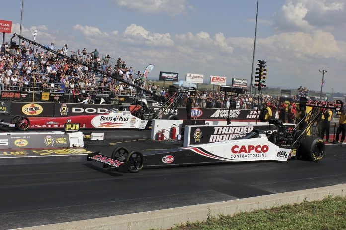 Steve Torrence (near lane) races Clay Millican in the Top Fuel final of Sunday's NHRA Mile-High Nationals at Bandimere Speedway. (Don Holbrook photo)