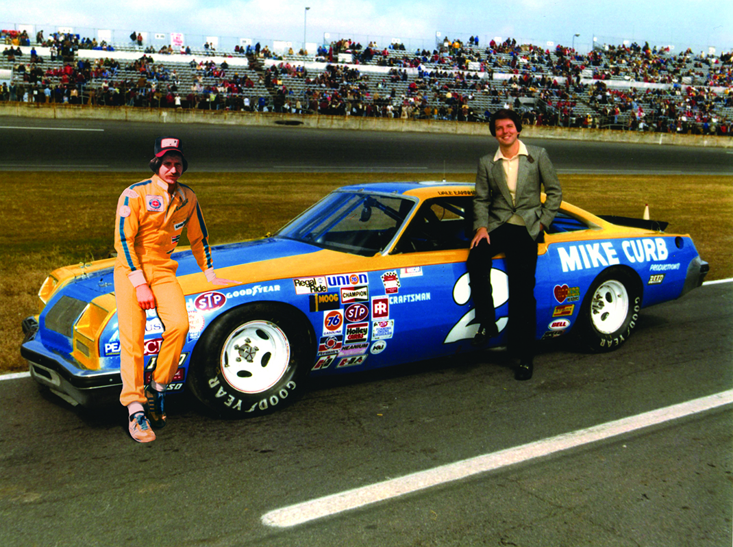 Dale Earnhardt (left) won the 1980 NASCAR Cup Series title with support from Mike Curb (right).