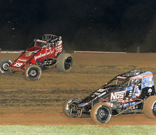 Kevin Thomas Jr. (19) races around Justin Grant at Bloomington Speedway. (Dick Ayers photo)