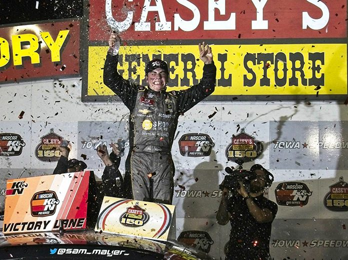 Sam Mayer celebrates after winning Friday's NASCAR K&N Pro Series event at Iowa Speedway. (Ray Hague Photo)