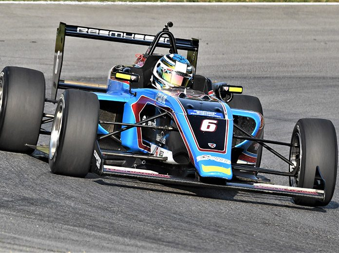 Christian Rasmussen on his way to victory Saturday at the Mid-Ohio Sports Car Course. (Al Steinberg Photo)
