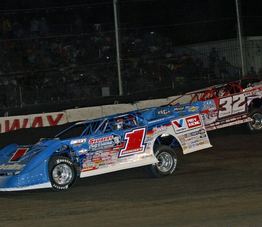 Brandon Sheppard (1) races under Bobby Pierce at Fairbury Speedway. (Jim DenHamer photo)