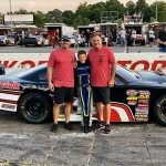 Conner Jones (center) is joined by Lee Faulk Racing and Development's Michael Faulk (left) and Lee Faulk after Jones finished third in his limited late model debut on Saturday at Hickory Motor Speedway. (MPM Marketing Photo)