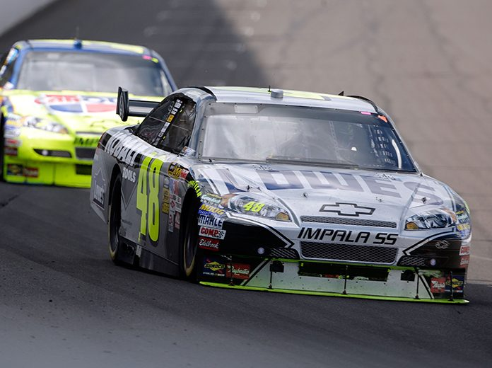 Jimmie Johnson (48) leads Mark Martin during the 2009 Allstate 400 at Indianapolis Motor Speedway. (NASCAR Photo)