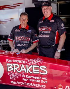 Clay Millican (left), seen here with Doug Herbert, will fly the colors of B.R.A.K.E.S. this weekend at the NHRA Northwest Nationals.