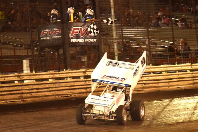 Ryan Giles takes the checkered flag Thursday night at Knoxville Raceway. (Paul Arch photo)