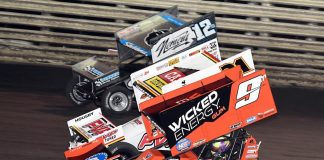 James McFadden (9) races under Brian Brown (21) and Joey Saldana at Knoxville Raceway. (Frank Smith photo)