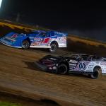 Chris Madden (0m) battles Brandon Sheppard at Cedar Lake Speedway. (Jacy Norgaard photo)